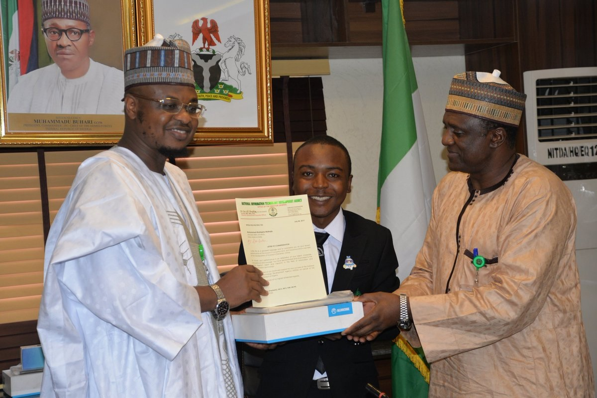 NITDA HONOURS ABU STUDENTS. Mustapha Maihaja (400L Computer Engineering) receiving the award