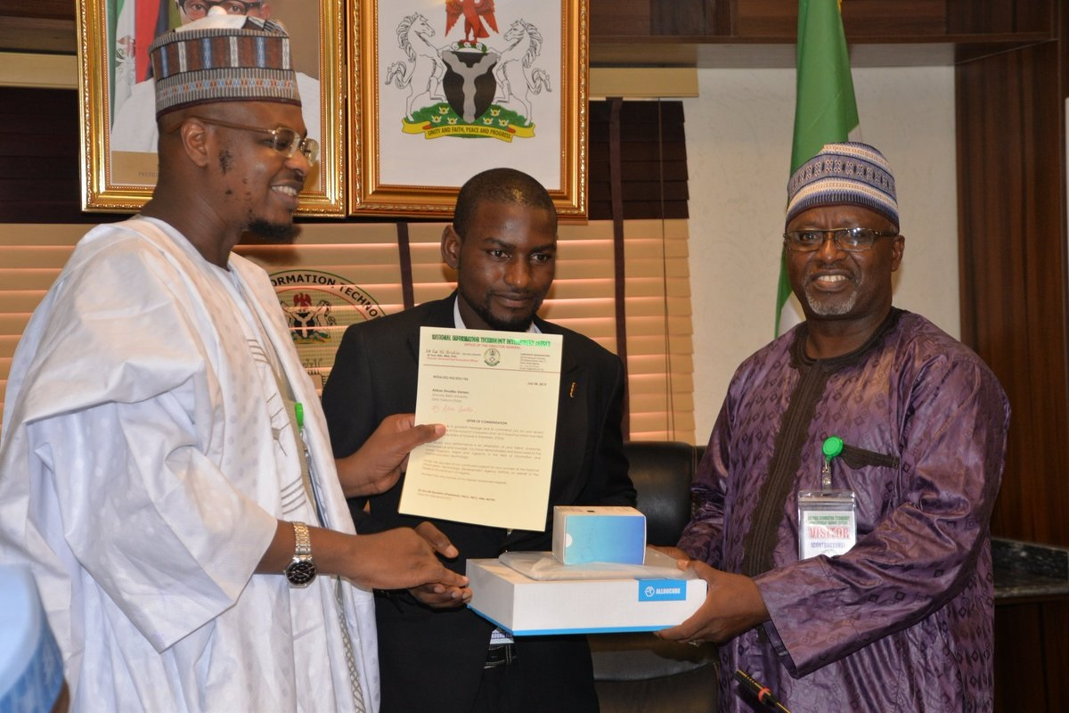 NITDA HONOURS ABU STUDENTS. Shuaibu Usman Abbas (400L Computer Science Education) receiving the award