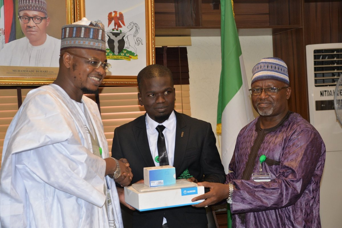 NITDA HONOURS ABU STUDENTS. Danladi Fahad (500L Computer Engineering) receiving the award