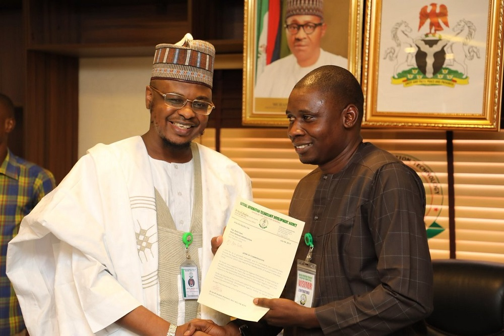 Head NIS Engr. Bashir H. Sani receiving letter of commendation